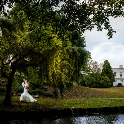 Bridge and groom in the landscaped gardens